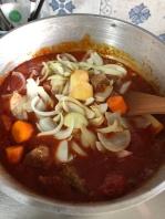 Add potatoes, carrots, onions